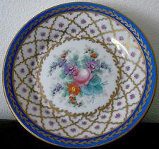 Coupe à fruit sur piédouche en porcelaine de Paris à décor peint de fleurs