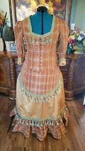 Victorian bustle dress reenactment in gold rust plaid taffeta
