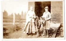 RPPC  real photo old farm couple with their favorite cow out for a walk#
