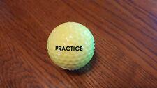 100 assorted yellow stripe range balls (used)