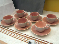 SIX SMALL COFFEE CUPS AND SAUCERS BY POOLE POTTERY IN PINK AND MOTTLED GREY