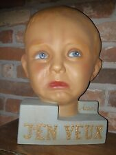 Detailed vintage French composition Advertising crying baby head