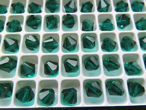36 Preciosa crystal bicone beads in 8mm Emerald color.