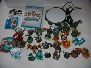 Skylanders Swap-Force for the Wii U. Comes with 26 Figurines, Portal, and Game.