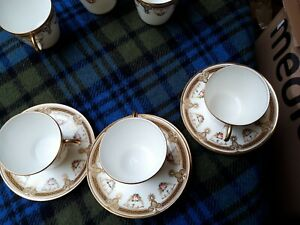Rare Vintage Porcelain cups x12 and saucers X 5 white with gold and pink flower