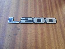 MITSUBISHI L200 K74 96 - 06 L200 FRONT DOOR BADGE