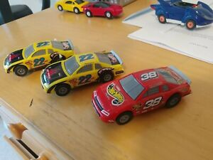 3x Hot Wheels slot cars NASCAR red #38 and 2x yellow #22 - 1998