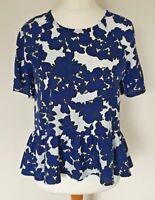 River Island Size 10 Ladies White Peplum Blouse/Top With Dark Blue Print