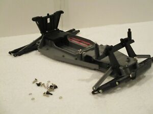 Traxxas Rustler XL-5 2wd Roller Slider Chassis VXL Parts New