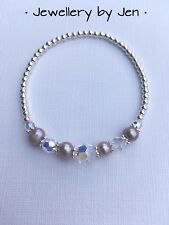 STERLING SILVER BEADED STRETCH BRACELET WITH SWAROVSKI CRYSTALS AND PINK PEARLS