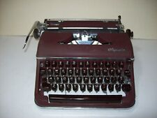 Classic Olympia  deluxe maroon typewriter with case