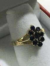 14k Gold Ring With A Cluster Of A Marquise And Round Sapphires