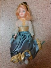 old vintage doll figurine open shut eyes cultural dress blonde hair blue eyes