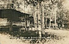 A Group of Small Cabins, Sleepy Hollow Lodge, Lake Hackensack MN RPPC 1935