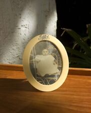 ANTIQUE VINTAGE CELLULOID PHOTO FRAME. LARGE OVAL W/ FANCY INITIALS. CHILD PHOTO