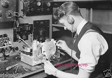 WORKER AT THE RCA VICTOR CAMDEN, N.J. PLANT TESTING RADIO FREQUENCY ALIGNMENT