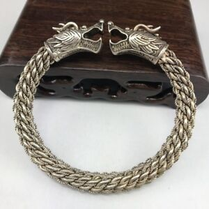 Inlaid with red stones Miao silver double dragon head copper bracelet