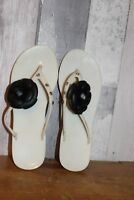 White jelly toe post flip flops with black rose and crystals 7