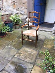 Early twentieth century beechwood and rush seat elbow chair