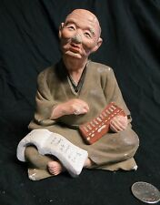 Japanese Hakata Doll Statue Merchant Man Abacus & Book Clay Ceramic Figurine