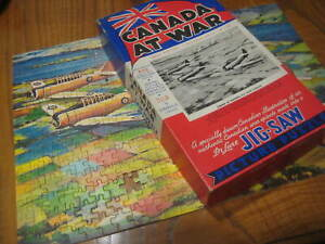1940 vintage CANADA AT WAR Jig-saw PUZZLE Airmen in training fly over Canada