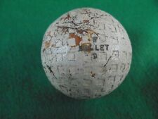"ANTIQUE GOLF BALL WITH SQUARE MESH DIMPLES AND MARKED ""BULLET""-SOME CRACKING"
