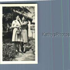 FOUND B&W PHOTO K_7964 TWO WOMEN ONE FEEDING THE OTHER