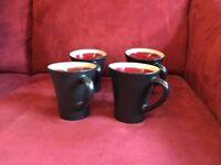 Set of 4 Black Gibson Elite Line Coffee Mugs Festive Carousel Pattern