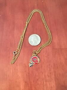 Buffalo Bills Helmet Team Logo Pendant With Gold tone necklace.