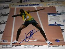 USAIN BOLT OLYMPIC GOLD SIGNED AUTOGRAPHED 8X10 PHOTOGRAPH-BECKETT COA BAS