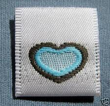 LOT OF 50 WOVEN CLOTHING LABELS,SIZE TAGS BLUE HEART
