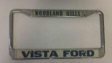 Woodland Hills CA Vista Ford metal license plate frame embossed dealership tag