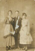 B&W Portrait of 3 Siblings Brother with Sisters Finely Dressed RPPC Postcard