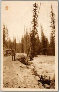 1928 RPPC Real Photo Postcard Man & Automobile / River - CASPER Wyoming Cancel