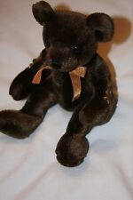 Small dark brown Teddy with year 2000 on arm - 23cm when seated