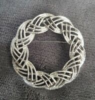 Vtg signed Sarah Coventry COV GB silvertone brooch circle Twist Knot statement