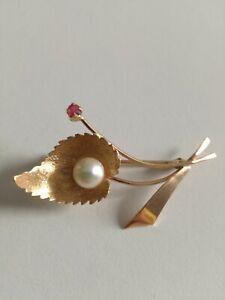 Spilla in oro 18K con perla e rubino