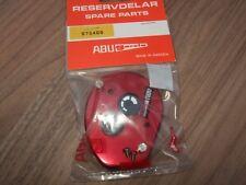 ABU AMBASSADEUR 1000 / 2000 RED RIGHT SIDE PLATE UNUSED IN PACKAGING