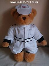 A NEW LINDON JOINTED BEAR IN A WHITE WITH BLACK TRIM FORMULA 1 STYLE RACING SUIT