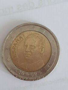 2 euros fauté recto/verso roi d'Espagne 2002. Axe non droit aussi