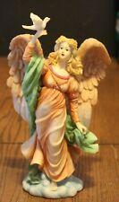 Angel Holding Dove Figurine