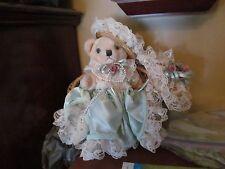 Beige Teddy Bear in Mint Green Dress w/Lace Outfit Sitting in Wicker Loveseat