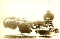 Battleship Royal Navy bombed on fire RPPC postcard antique military