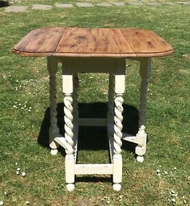 Oak drop leaf table  barley Twist with lovely finish to top stunning (27) square