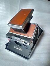 Polaroid SX-70 SLR. Land Camera. Silver. Brown Leather. Vintage item used.