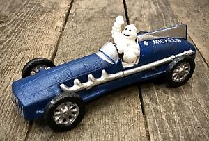 Michelin Man Bibendum Cast Iron Blue Race Car