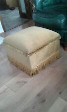 pouffe on wheels in beautiful gold dralon with heavy fringing