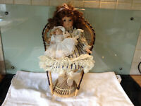 2 PORCELAIN DOLLS in WHICKER PEACOCK CHAIR- GREAT CONDITION!