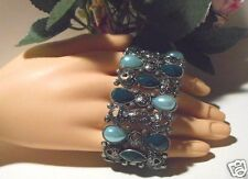 Glittering bracelet with antique silver colored scrolls and  blue & green stones