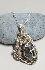 Stunning Botswana Agate Gemstone intricately wrapped in silver plated wire